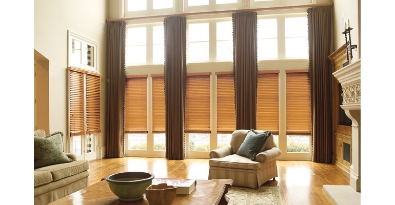 Gainesville great room with natural wood blinds and floor to ceiling drapes.